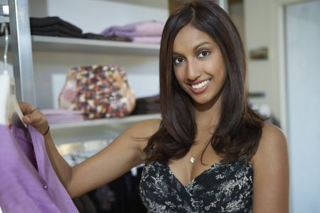Portrait of woman at clothes shop Stock Photo - 3540780