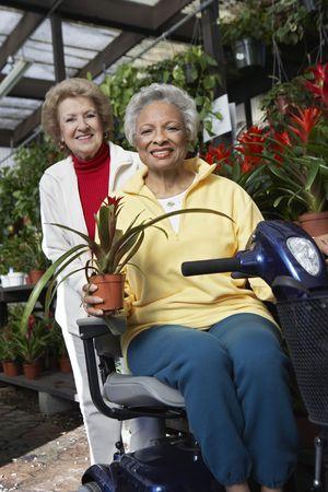 Two senior women in garden center Stock Photo - 3540923