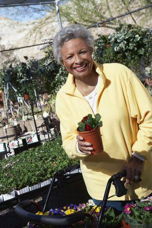 Senior woman in garden center Stock Photo - 3540922