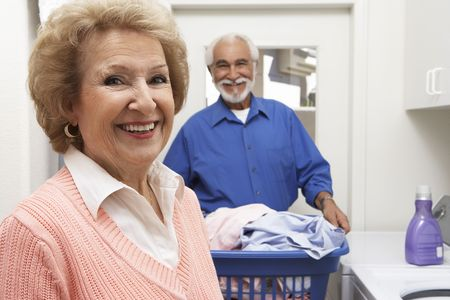 Senior couple with laundry Stock Photo - 3540845