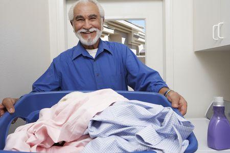Elderly man with laundry basket Stock Photo - 3540493