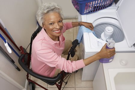 Woman doing laundry at home Stock Photo - 3540787