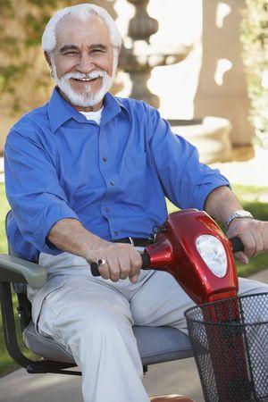 scooter: Elderly man on motor scooter LANG_EVOIMAGES