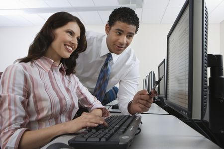 Man and woman using computer together Stock Photo - 3540753