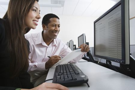 Man and woman using computer together Stock Photo - 3540791
