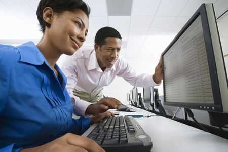 Man and woman using computer together Stock Photo - 3540869