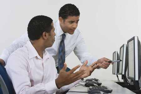 Two business men discussing in front of computer Stock Photo - 3540496