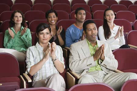 People sitting in auditorium and clapping hands Stock Photo - 3540961