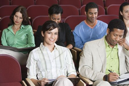 People sitting in auditorium and clapping hands Stock Photo - 3540952