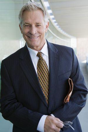 senior business man: Businessman indoors, portrait