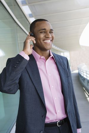 Mid adult man using cell phone on balcony Stock Photo - 3540917