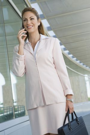 Businesswoman using cell phone on balcony Stock Photo - 3540681