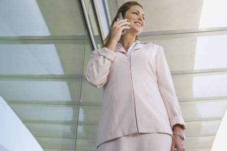 Businesswoman using cell phone on balcony Stock Photo - 3540683