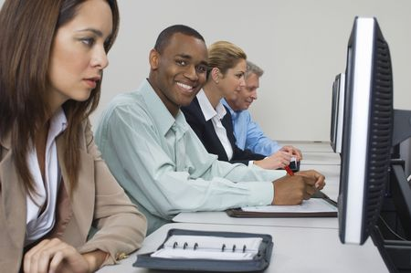 Group of business people using computers in classroom, side view Stock Photo - 3540514