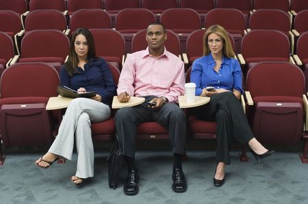 Business people sitting in auditorium Stock Photo - 3540983