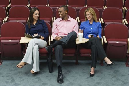 Business people sitting in auditorium Stock Photo - 3540992