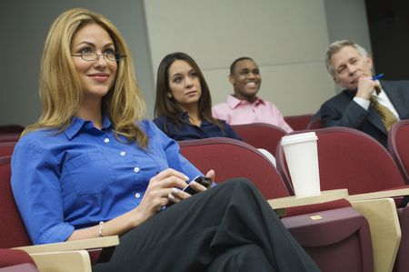 Business people sitting in auditorium Stock Photo - 3540896