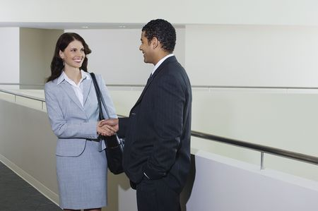 Business couple shaking hands in office hallway Stock Photo - 3540859
