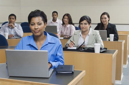 Business people sitting in classroom Stock Photo - 3540959