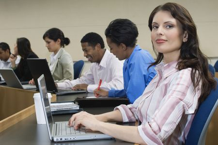 Business people sitting in classroom Stock Photo - 3540846