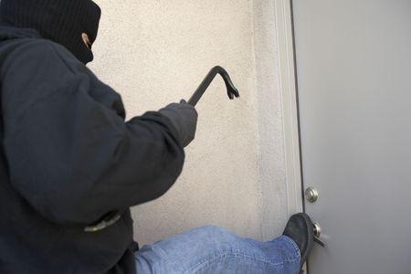 Burglar kicking door of Stock Photo - 3540949