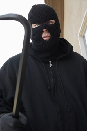 Man wearing balaclava and holding crowbar Stock Photo - 3540783