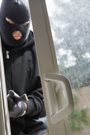 Burglar breaking into house Stock Photo - 3540803