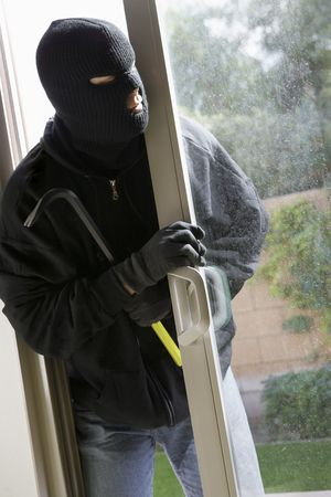 balaclava: Burglar breaking into house