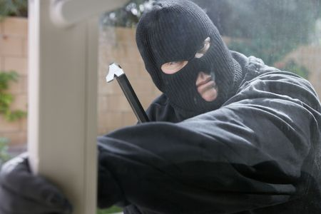 Burglar breaking into house Stock Photo - 3540824