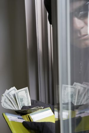 Burglar stealing money, close-up Stock Photo - 3540823