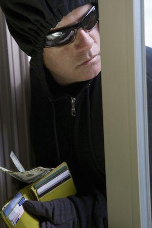 Burglar stealing money, close-up Stock Photo - 3540937