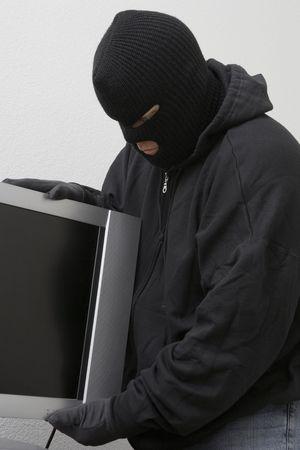 Burglar stealing television set Stock Photo - 3540974