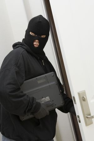 Burglar stealing laptop Stock Photo - 3540740