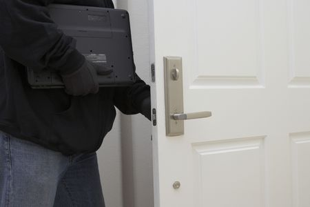 Burglar stealing laptop, mid section Stock Photo - 3540761