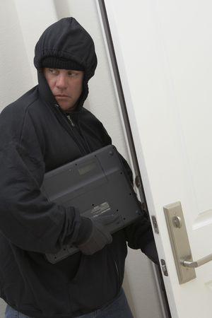 Burglar stealing laptop Stock Photo - 3540735