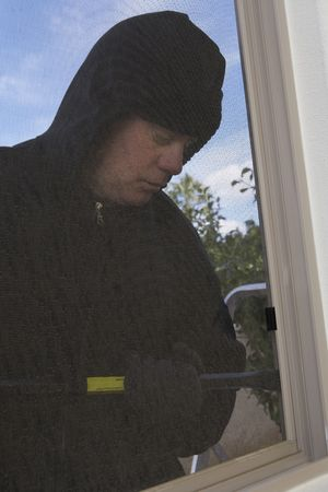 Burglar breaking into  Stock Photo - 3541006