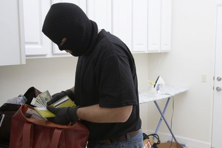 Burglar stealing money from house, close-up Stock Photo - 3540711
