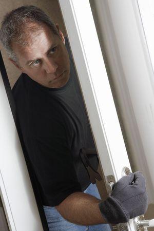 Burglar breaking into house Stock Photo - 3540829