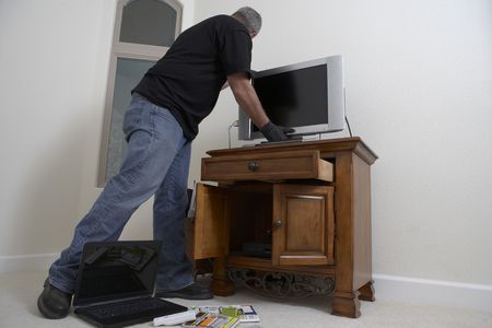 Burglar stealing television from Stock Photo - 3540971
