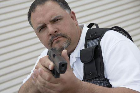 Portrait of security guard in bulletproof vest holding gun Stock Photo - 3540773