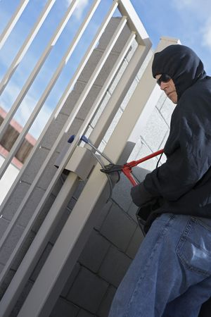 Thief cutting lock Stock Photo - 3540814
