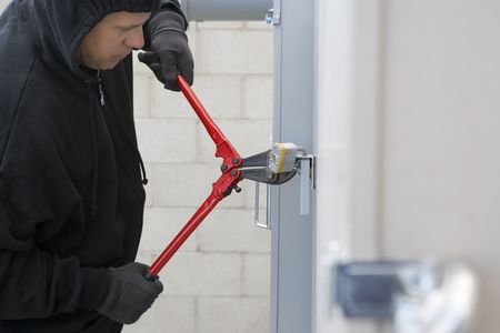Thief cutting lock Stock Photo - 3540706