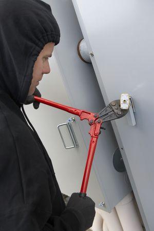 Thief cutting lock Stock Photo - 3540704