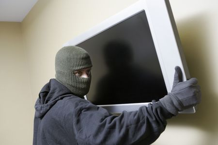 Thief stealing flat screen television Stock Photo - 3540771