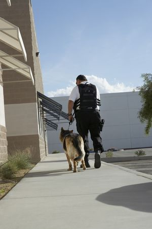 a patrol: Security guard with dog on patrol