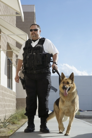 Security guard with dog on patrol Stock Photo - 3540749