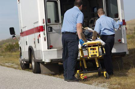 Paramedics transporting victim on stretcher