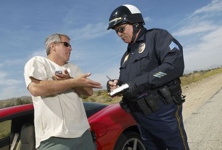 traffic ticket: Traffic cop talking with driver of sports car