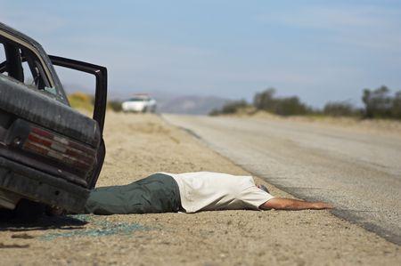 Victim of car accident lying on roadside