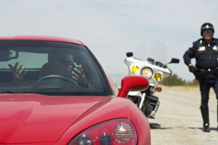 Traffic cop stopping sports car Stock Photo - 3540492